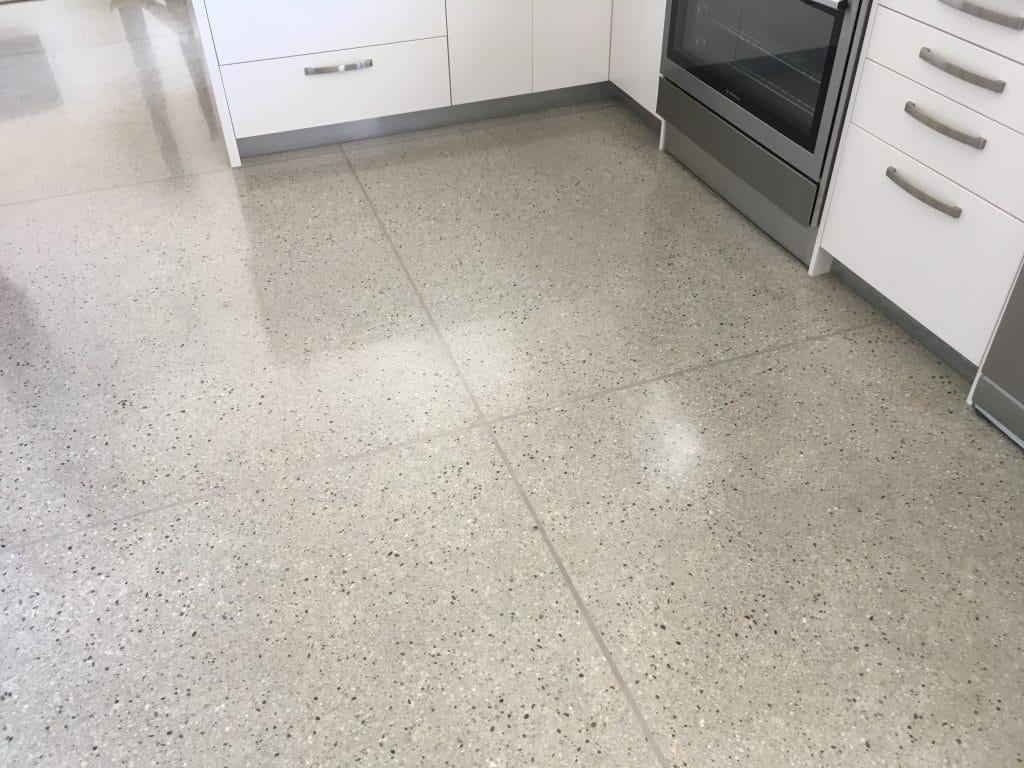 Smaller white & black coloured aggregate added to lighter coloured concrete