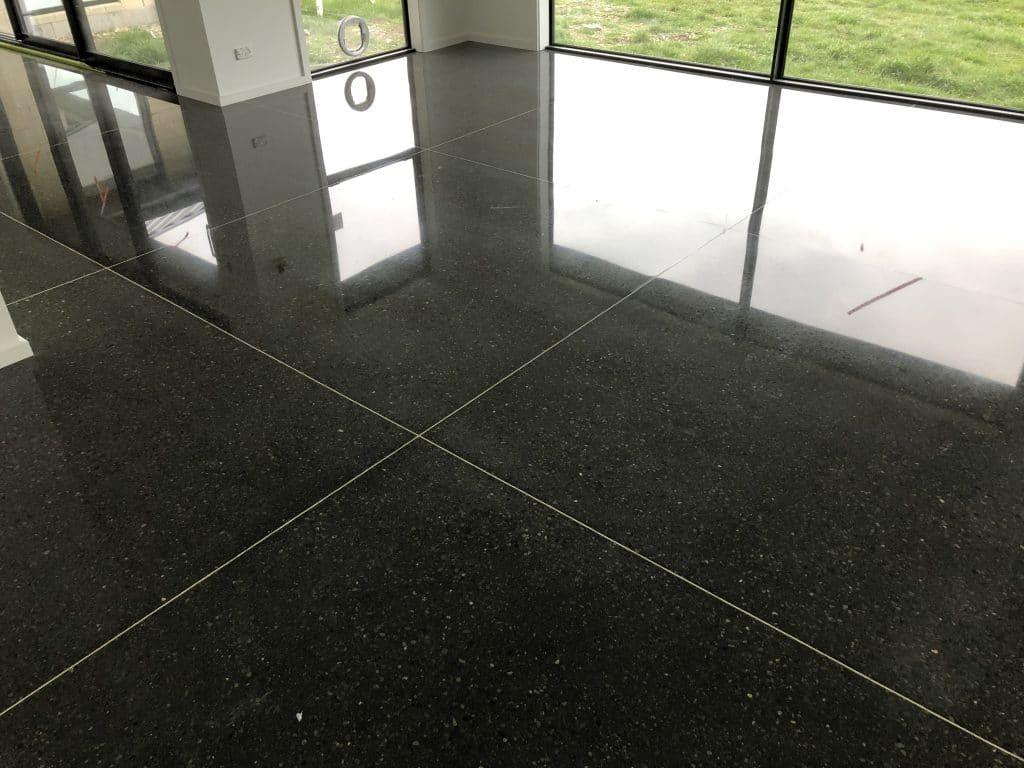Black Oxide added to concrete & black aggregate chose; decorative lighter coloured grout lines